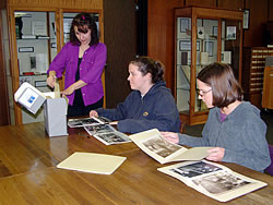 Special Collections and Archives - 12th floor Library; patrons reviewing collection with assistant