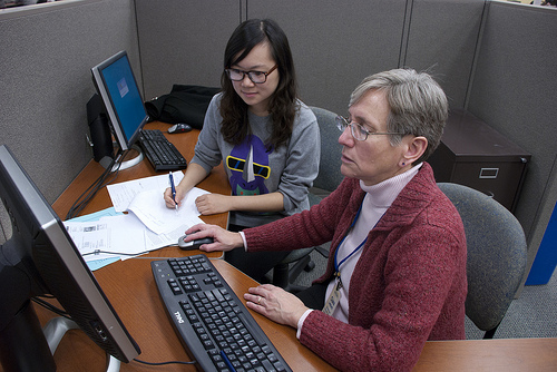 Reference librarian working with a student