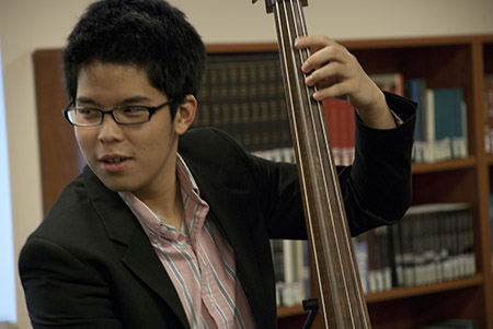 Student performing at Performing Arts Library event.